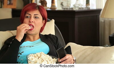 Woman with redhead watching tv at home - Red hair woman...