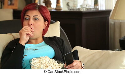 Woman with redhead watching tv at home - Portrait of a red...