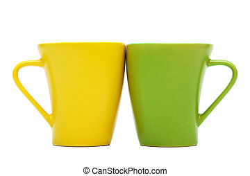 yellow and green mug on a white background