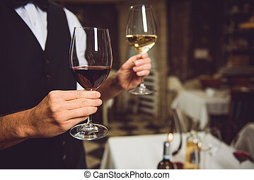 Wine perfection in hands of connoisseur - Close up of two...