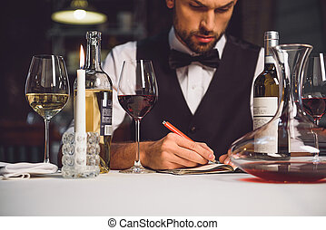 Alcohol critic writing his recommendation - Concentrated...