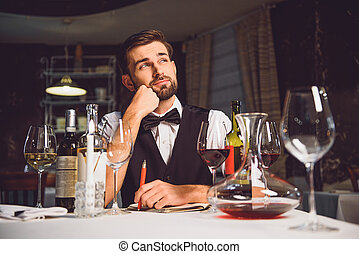 Man sitting and absorbedly thinking - Gourmet is sitting at...