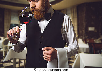 Man inhaling race of wine