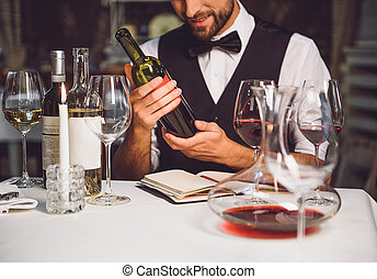 Wine variety in hands of sommelier - Softly smiling man is...