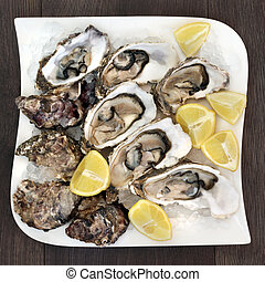 Fresh Oysters on Ice - Fresh oysters on crushed ice with...
