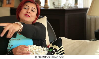 Woman with redhead watching tv at home - Portrait of red...