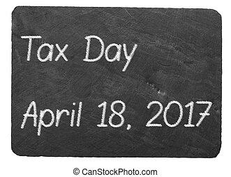 Tax Day concept using chalk on slate blackboard - Tax...