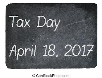 Tax Day concept using chalk on slate blackboard - Tax return...