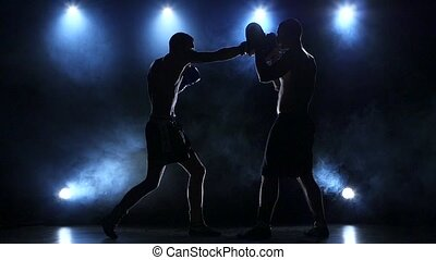 Coach helps the boxer to fulfill kick. Slow motion - Two...