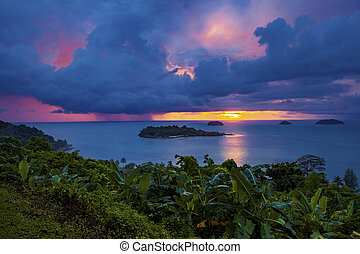 raining over blue sea at sunset time koh chang island trad...