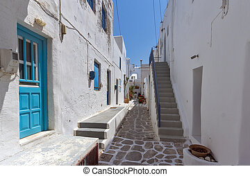 Steet and Old stone house in Naoussa town, Paros island,...