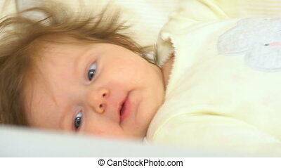 Adorable baby in the bed