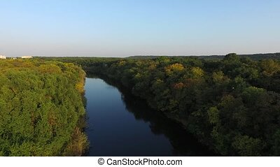 Nature. River turns among the trees. View from above - River...