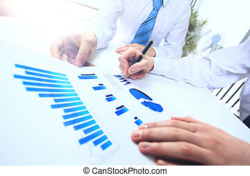 Close-up of business people working with documentation