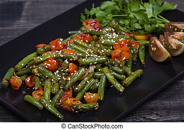 Healthy green beans, red cherry tomato with sesame seeds -...