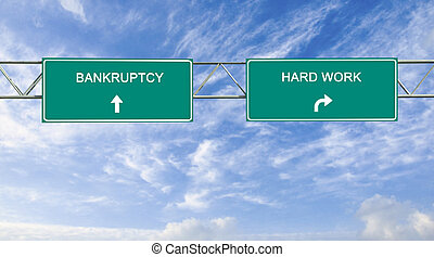 Road sign to bankruptcy and hard work
