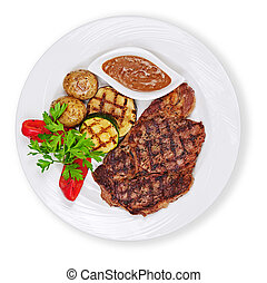 Grilled steak, potatoes and vegetables isolated on white background.