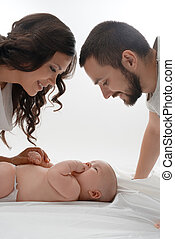 Happy young family with newborn baby - Young loving parents....