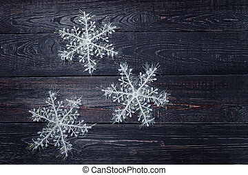festive pack of 3 white snowflake lying on the wooden background
