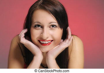 The smiling young attractive woman