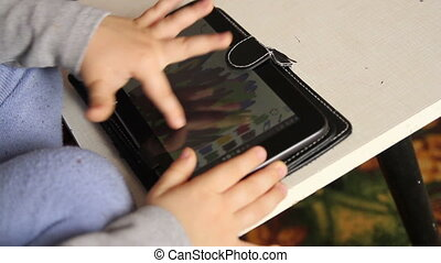 baby finger play with tablet touchscreen, paint