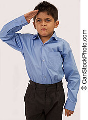 Boy Saluting - Portrait of a young boy saluting