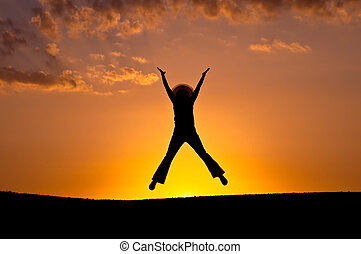 Elation jump. Silhouette - Female silhouette in a jump of...
