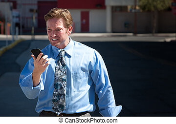 Upset, good-looking man angry with cell phone - Frustrated...