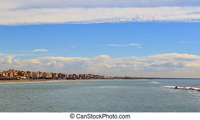 Clouds over the coast. Zoom. Ostia, Rome, Italy. Time Lapse....