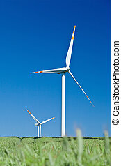 wind turbines and blue sky from grass level