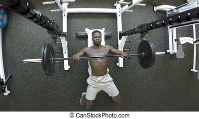 Gym - Black man is training in Gym