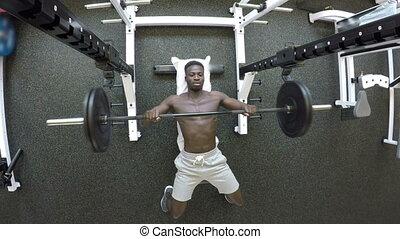 Gym - Black man is training in Gym