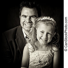 portrait of father and daughter on black