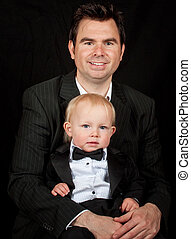 portrait of father and child son on black