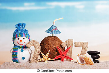 Christmas beach with the inscription 2017, snowman and...