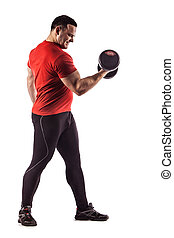 Sexy athletic man showing muscular body with dumbbells, isolated over white background.
