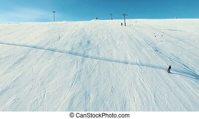Lifting by the ski-lift to the summit. - Several people...