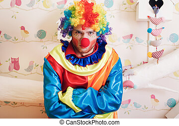Angry clown with rainbow colored hairstyle. - Portrait of...