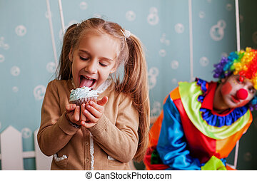 Girl eating birthday cake. - Happy little girl eating...