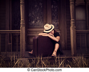 Woman sitting on threshold of old house. - Portrate of young...