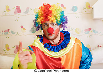 Clown in funny costume show finger. Decorative birds and...