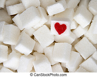 Sugar cubes with a red heart on one of them. Top view. Diet...
