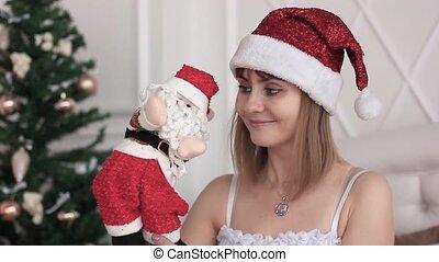 girl with Santa doll - Christmas woman shopping santa claus...