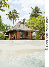 bungalow - View of nice bungalow on tropical empty sandy...