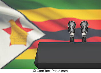 Pulpit and two microphones with a national flag on...