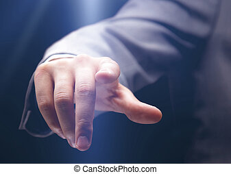 Businessman pressing an imaginary button - Hand pushing the...