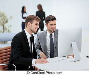 Successful business team at the workplace - Smiling business...