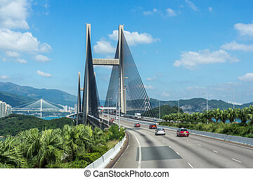 Passing through the Suspension Kap Shui Mun bridge in Hong...