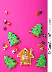 Christmas sweets on pink background