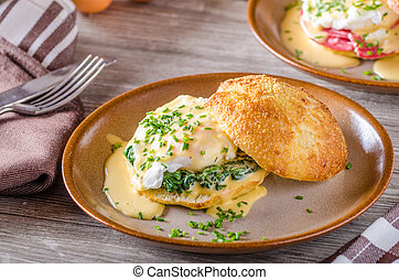 Egg benedict with hollandaise sauce, fresh pastry
